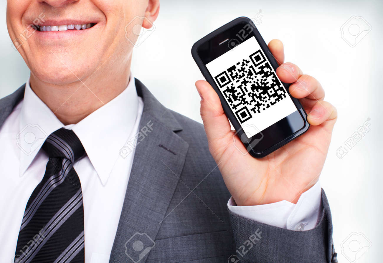 Businessman with a cell phone Stock Photo - 13098152