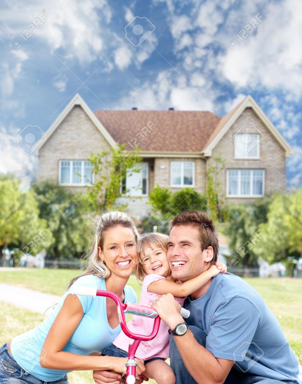 Happy family near new house - 14900505