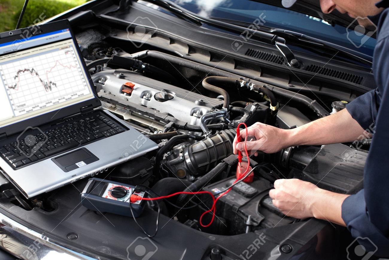 Car mechanic working in auto repair service Stock Photo - 16279148