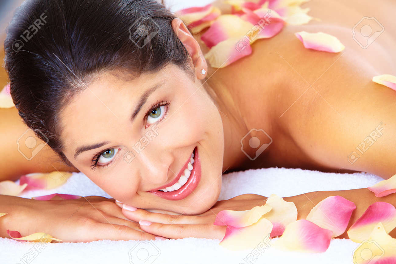 Young beautiful woman getting massage in spa salon. Stock Photo - 16959021