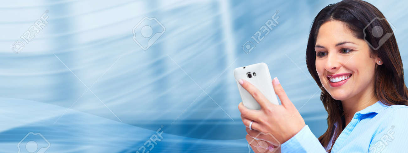 Business woman with a smartphone Stock Photo - 17245171