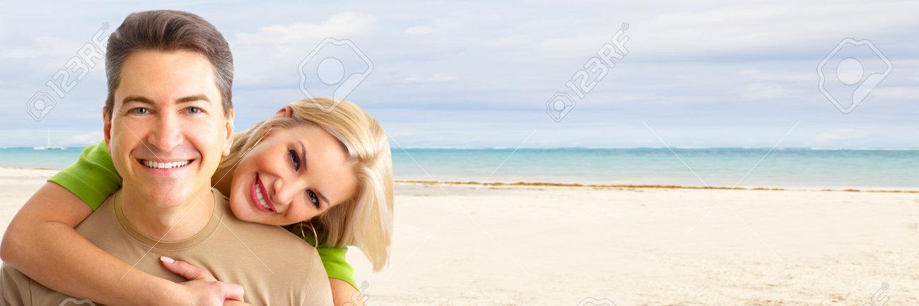Happy couple on the beach Stock Photo - 17254665