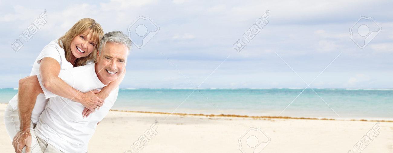 Happy senior couple on the beach Stock Photo - 17414993