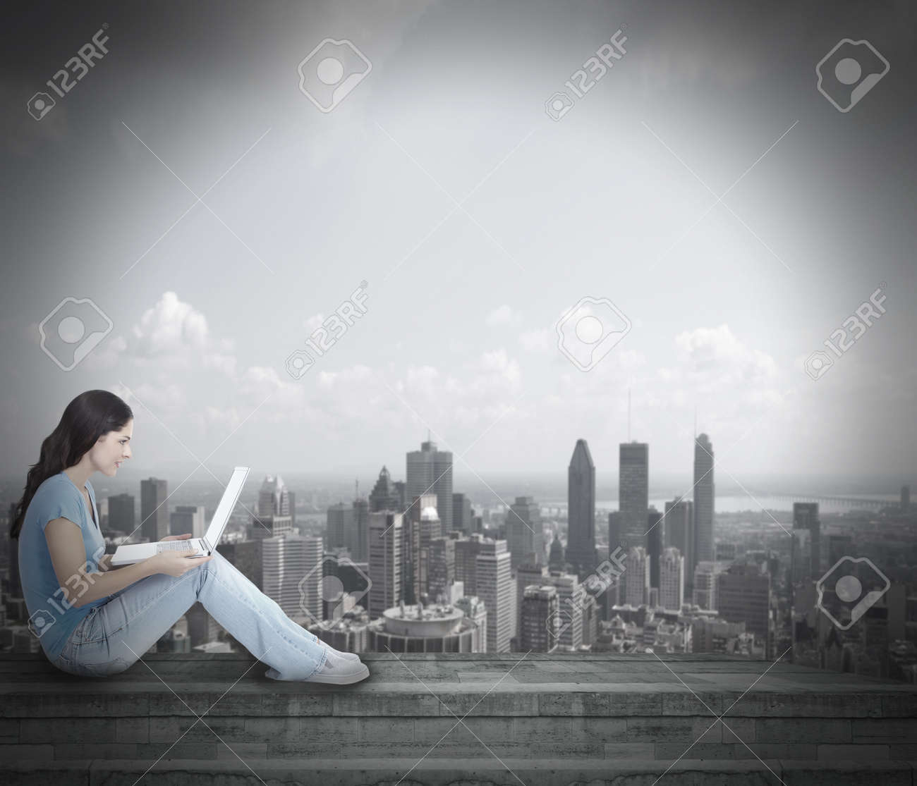 Young woman with laptop computer Stock Photo - 17573229