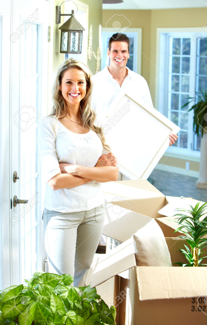 Happy couple moving in a new house Stock Photo - 17878179