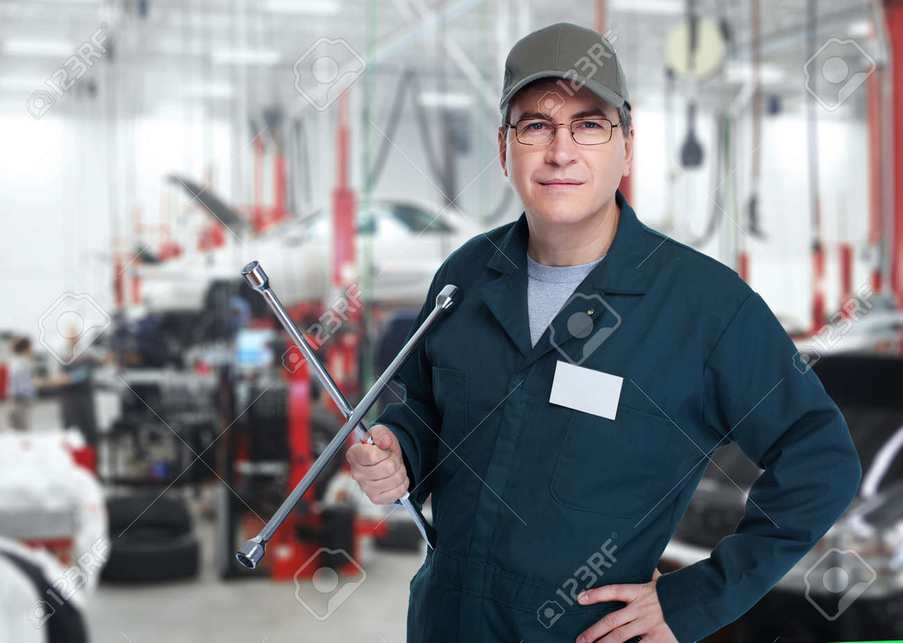 Auto mechanic with a wheel wrench Stock Photo - 18767739