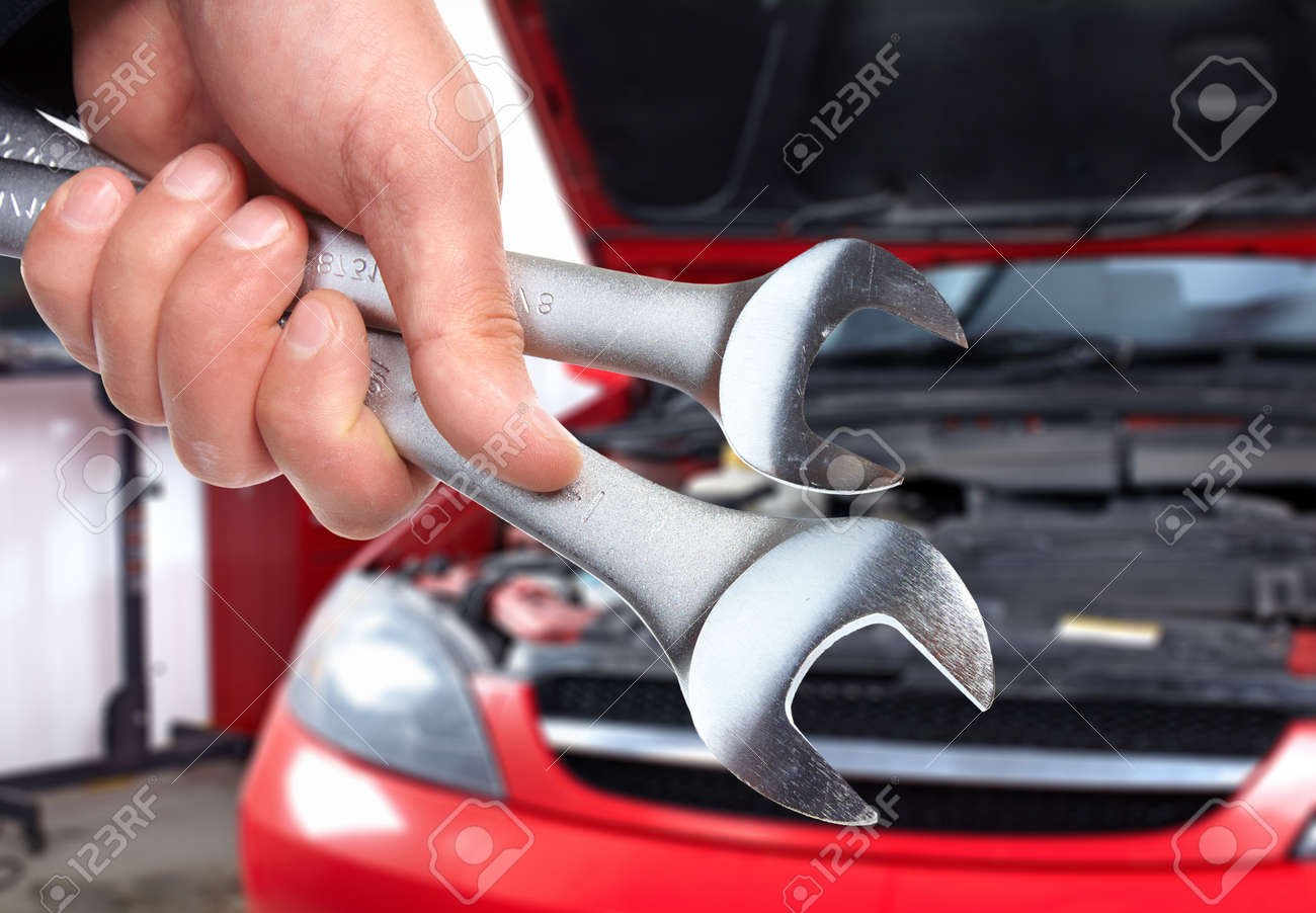 Hand with wrench  Auto mechanic Stock Photo - 19354707