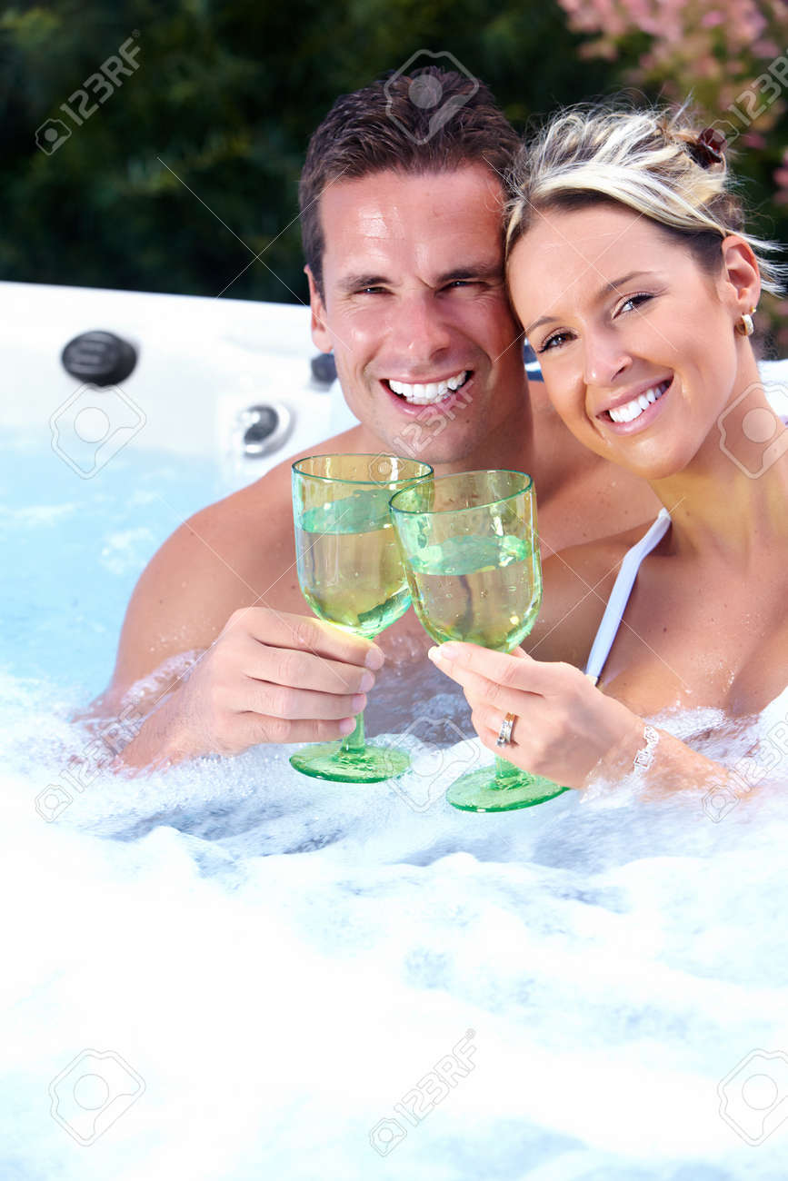 Happy couple relaxing in hot tub. Vacation. Stock Photo - 21492749