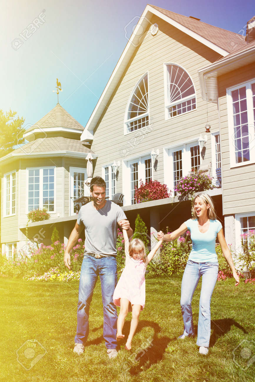 Happy smiling family with child over  house background Stock Photo - 22218681