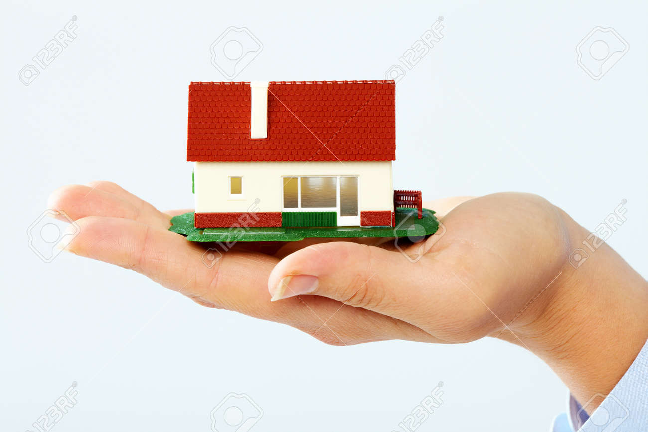 Hands holding Family house model. Real estate background. Stock Photo - 22724226