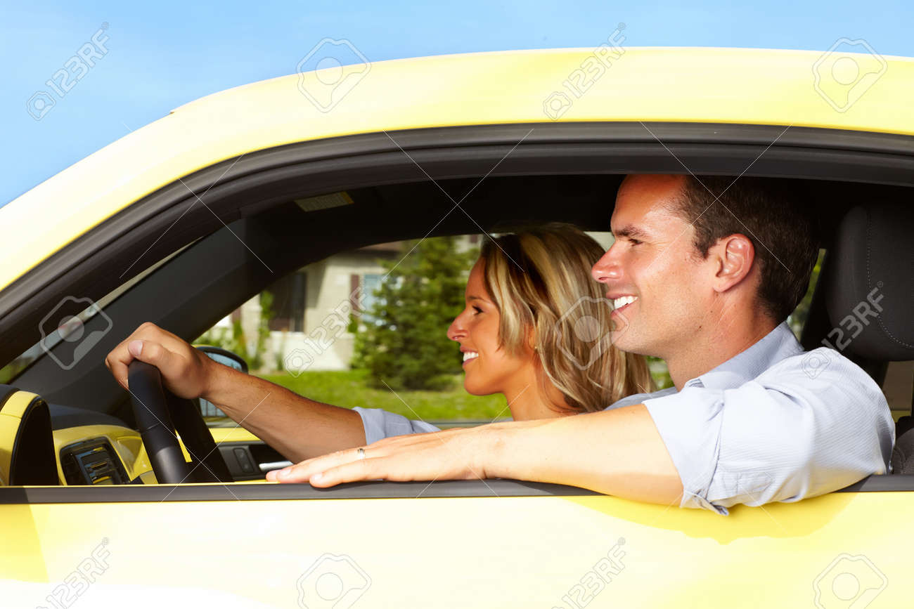 Happy young man driver in a new car. Stock Photo - 22934900