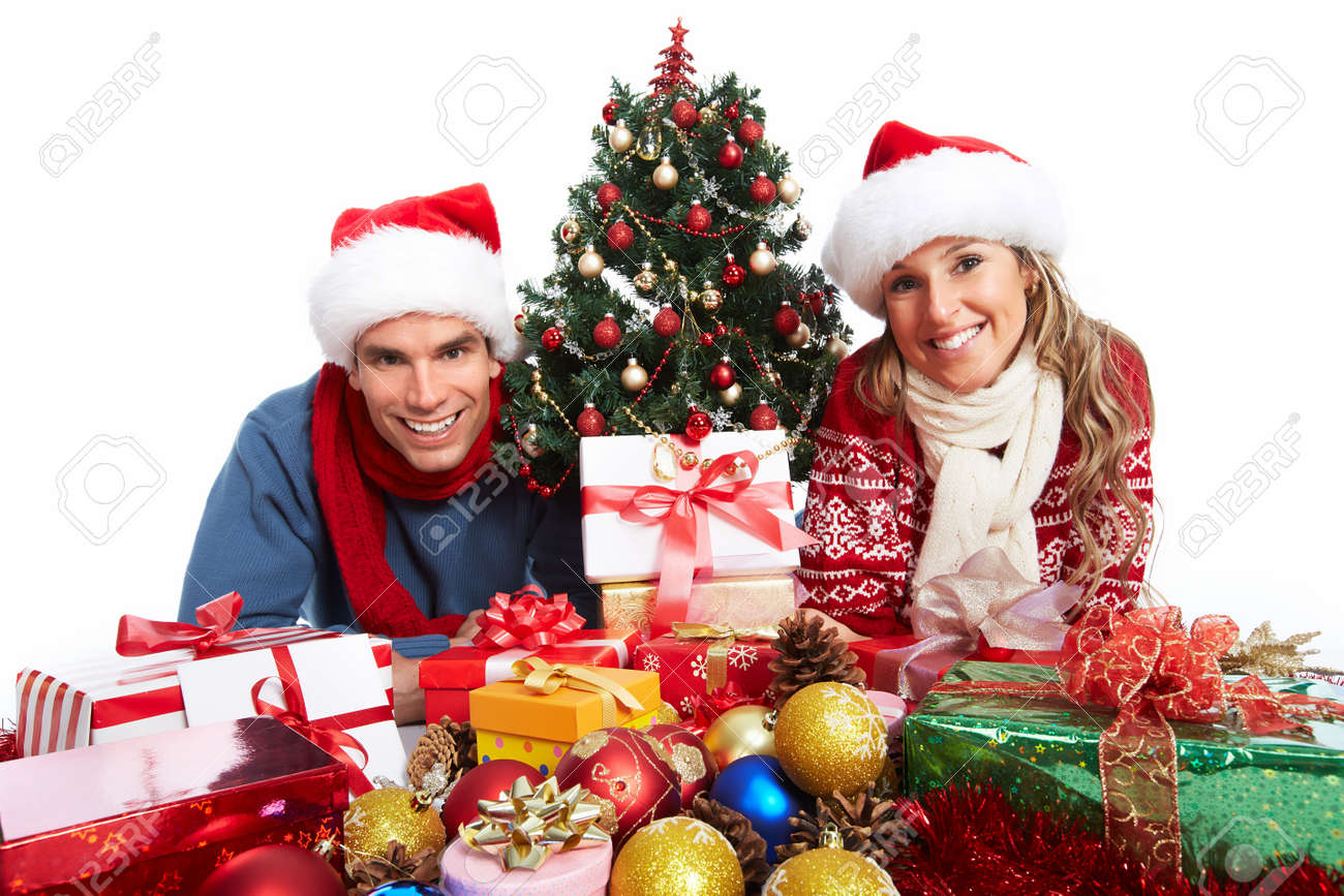 Happy couple with christmas present isolated over white background. Stock Photo - 24051560