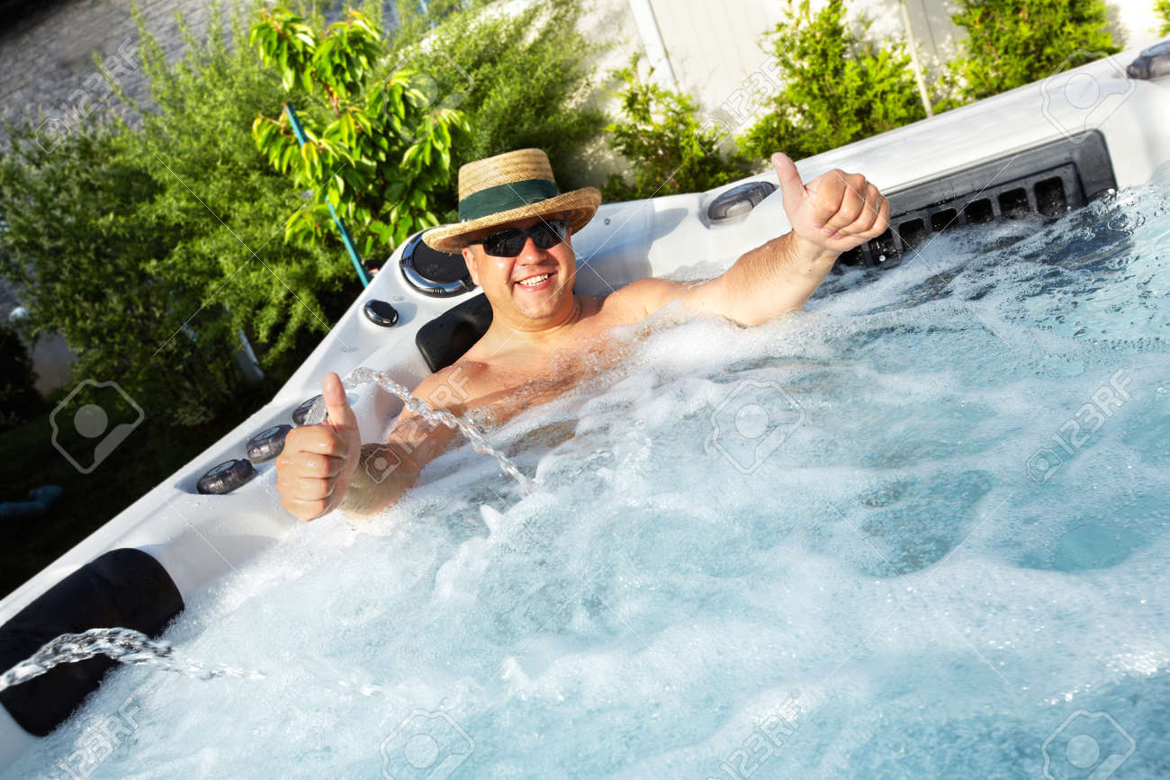 Man Having Massage In Hot Tub Spa. Stock Photo, Picture And Royalty ...