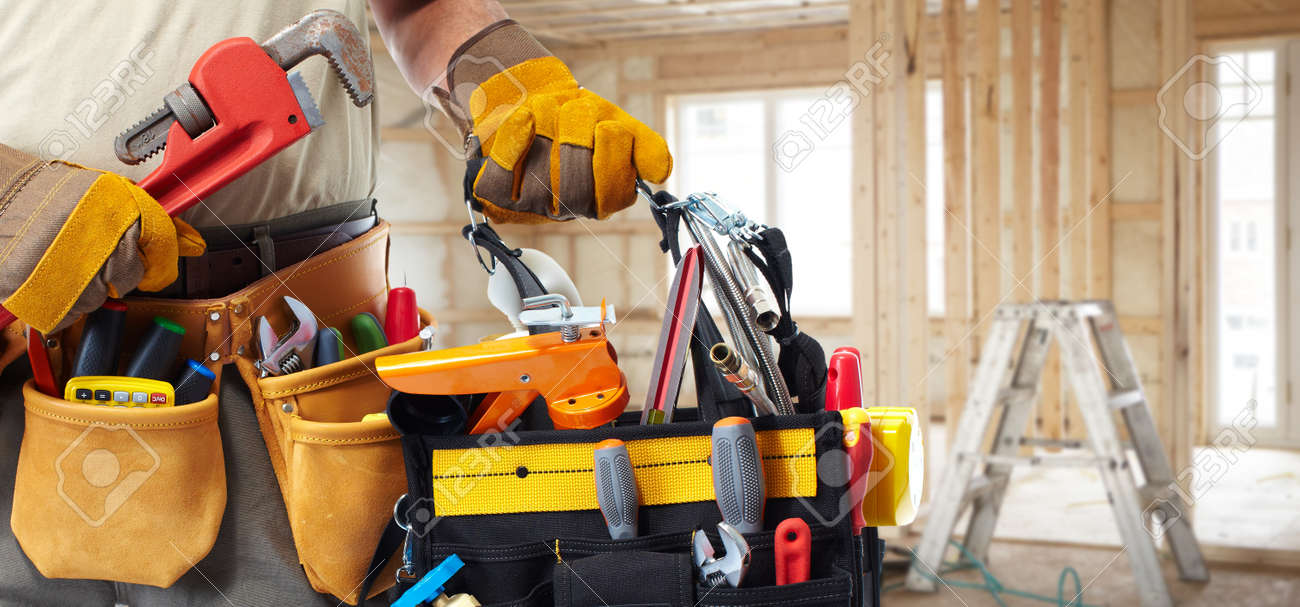 builder handyman with construction tools stock photo picture and