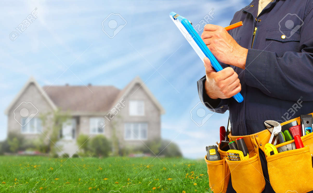 Builder handyman with construction tools. - 37620064