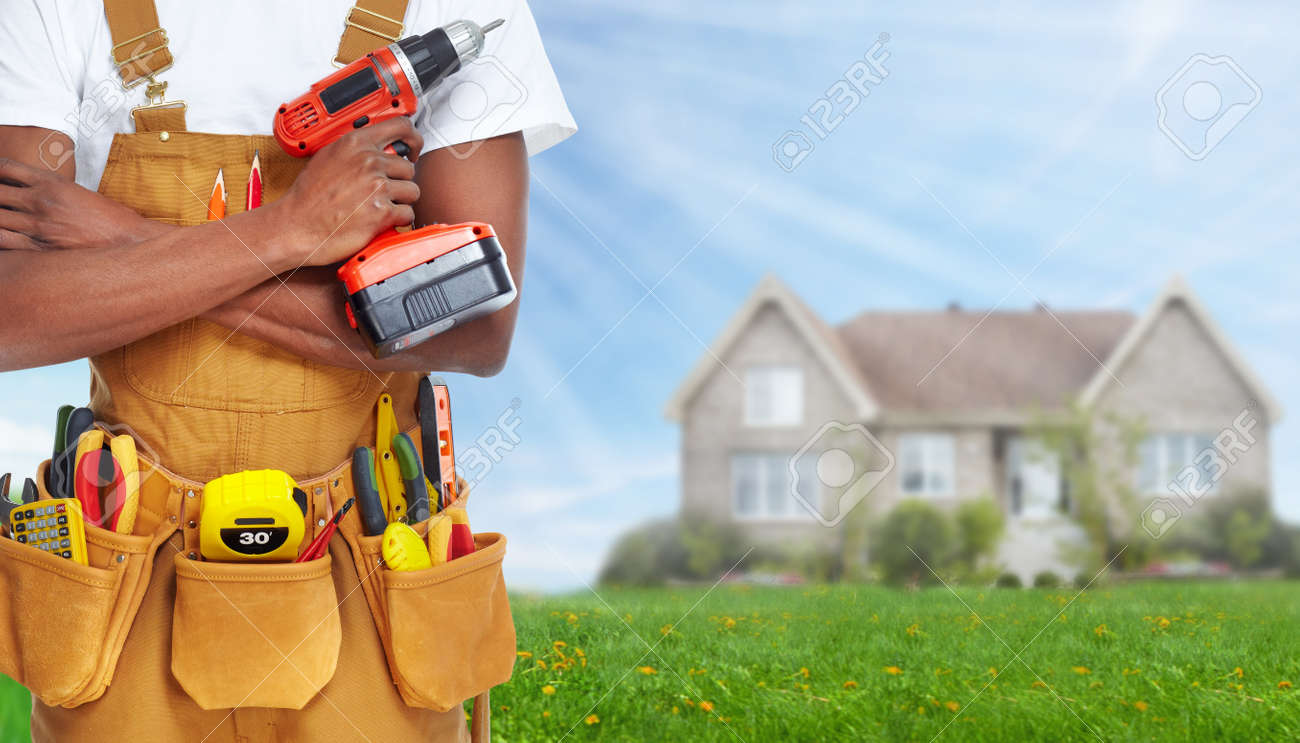 Builder handyman with construction tools. - 37621085