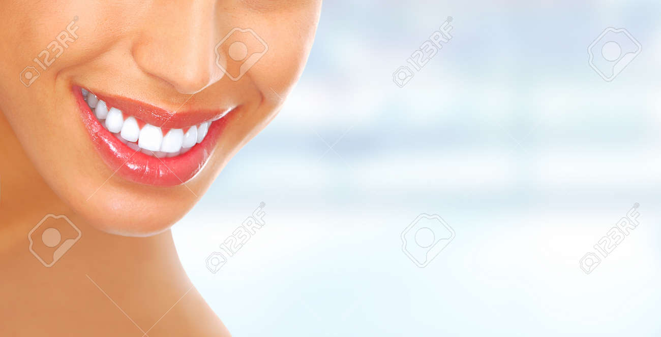 Laughing woman mouth with great teeth over blue background. Stock Photo - 45541607