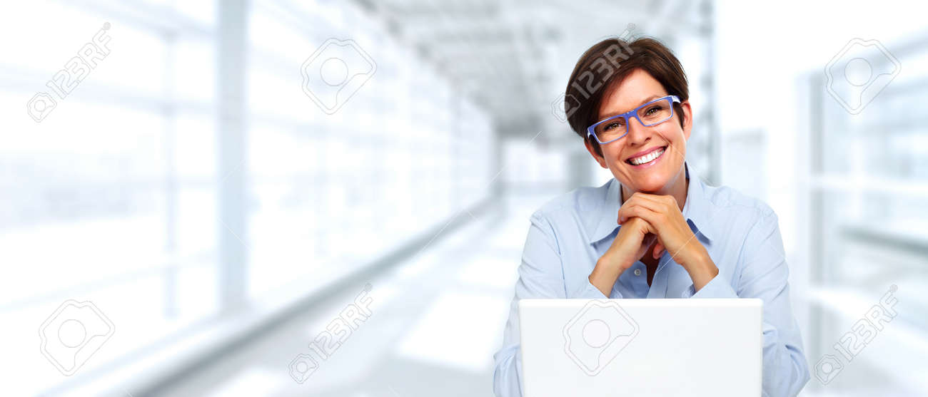 lady with laptop  Beautiful Business Lady With Laptop Computer In Office. Stock Photo ...