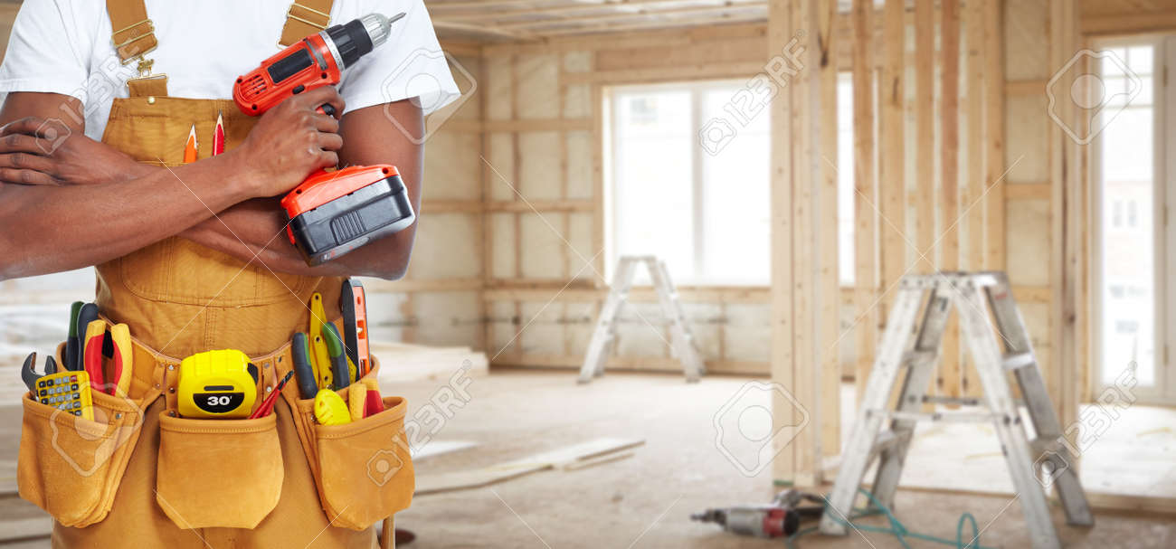 builder handyman with construction tools house renovation