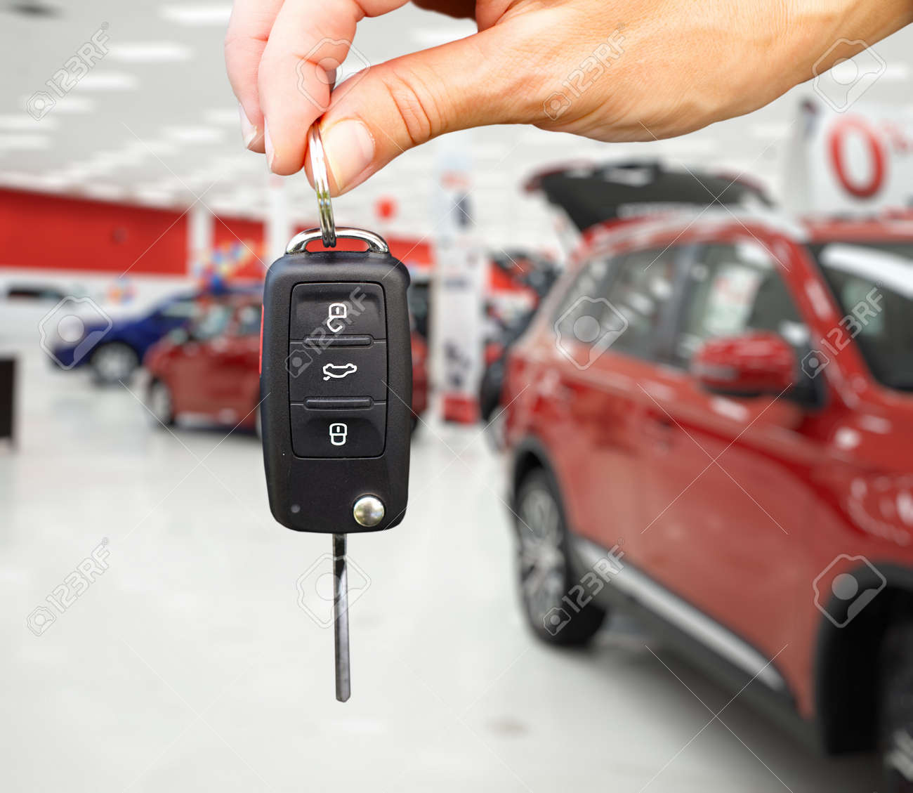 Key Car Dealership >> Hand With A Car Key Auto Dealership And Rental Concept Background
