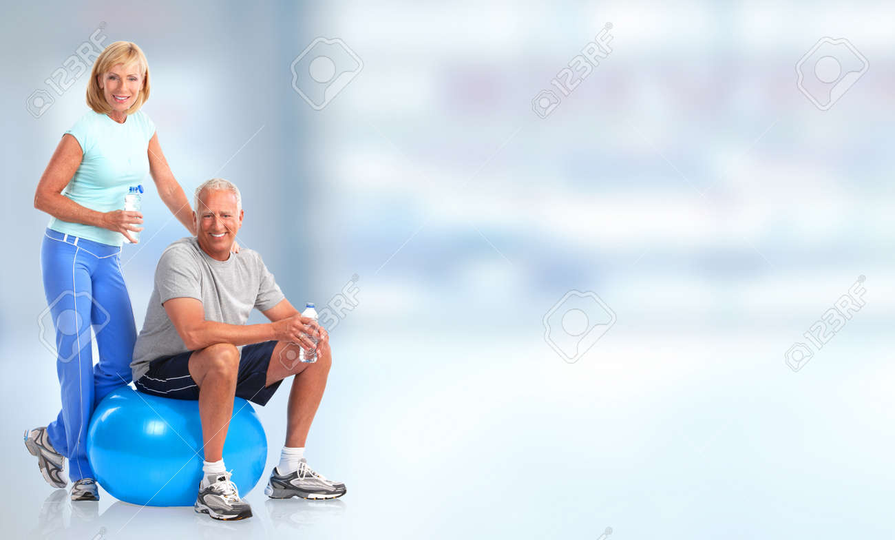 Senior healthy fitness couple. Over blue background Stock Photo - 47864009