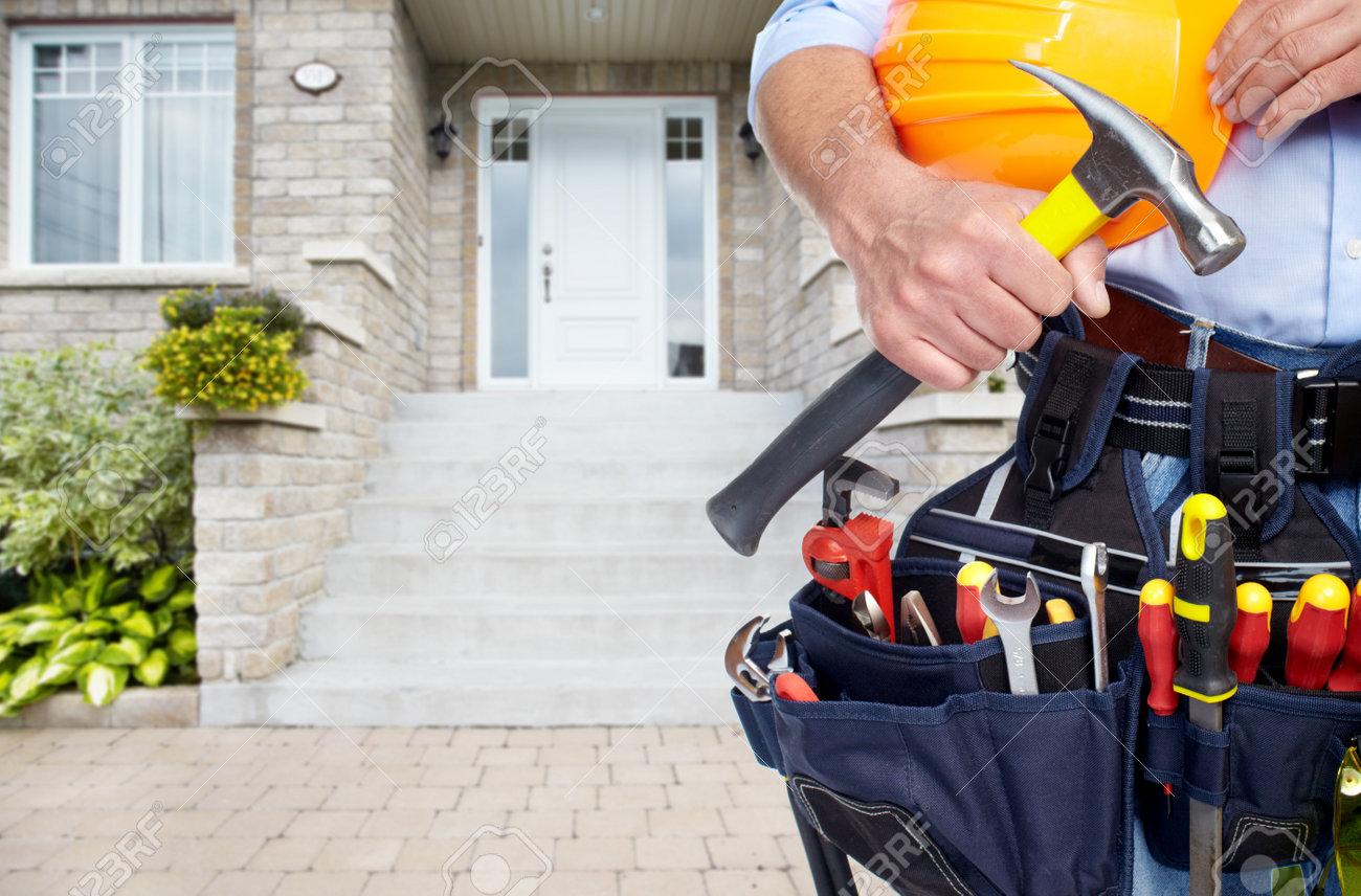 Handyman with a tool belt. House renovation service. Stock Photo - 51262447