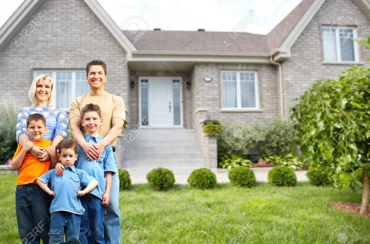 Happy family with children near new house. Construction and real estate concept. - 51262454