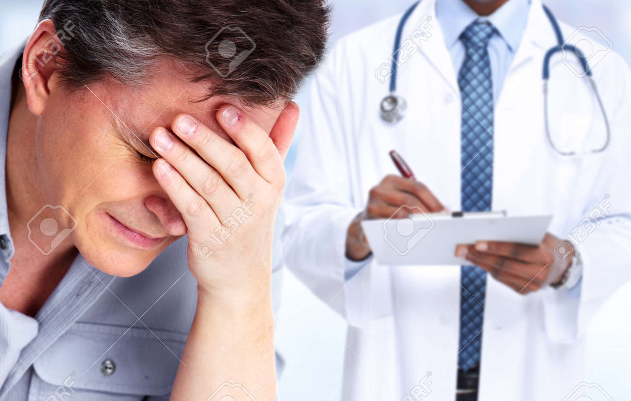 Tired man with headache migraine. Stress and health. - 51262503