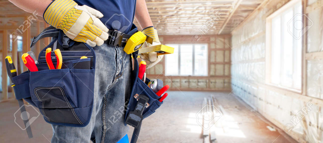 Builder handyman with construction tools. House renovation background. - 51262638