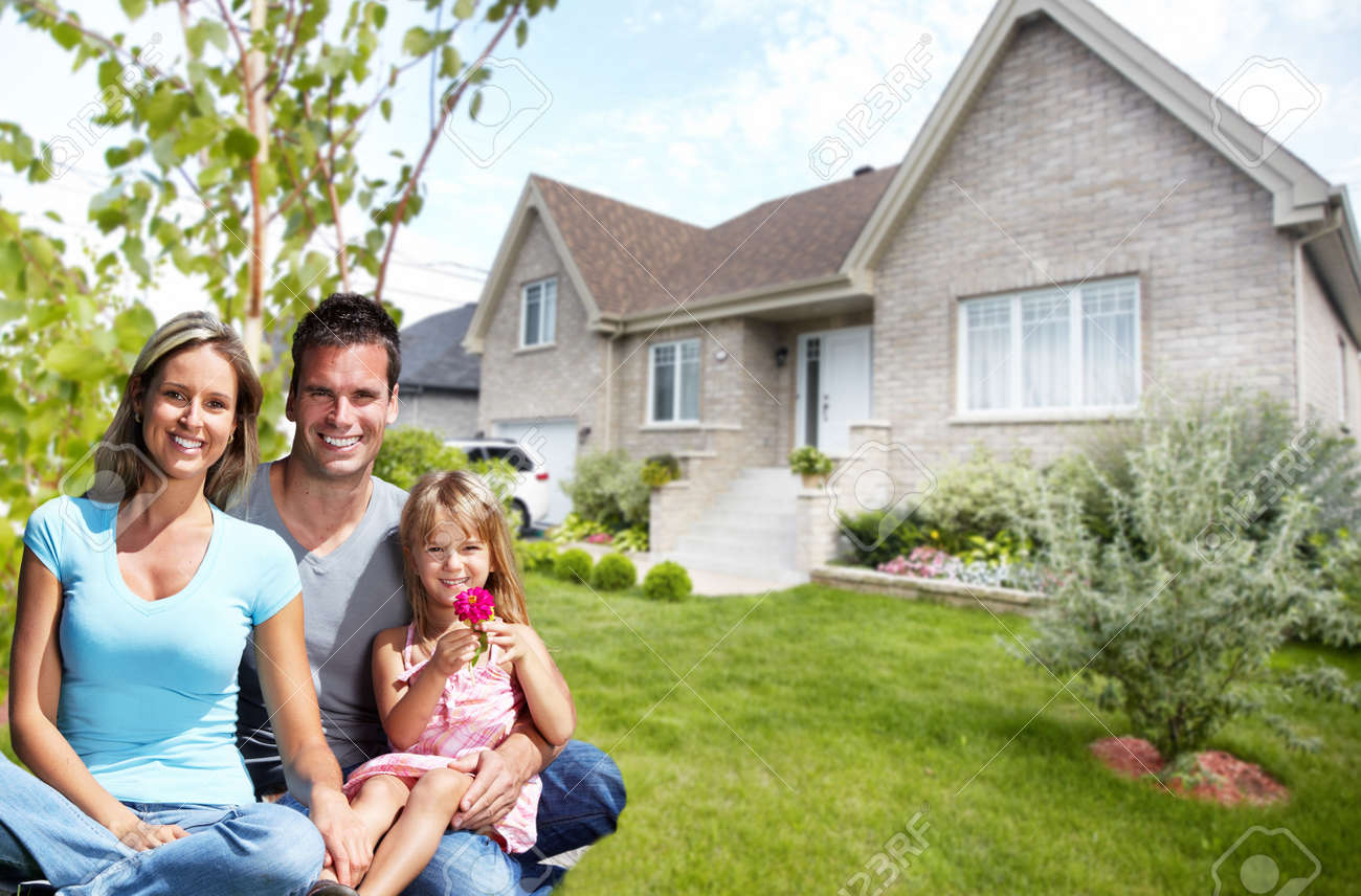 Happy family with children near new house. Construction and real estate concept. Standard-Bild - 52424023