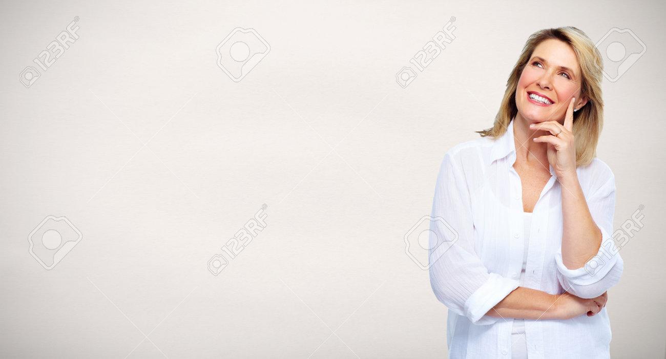 Beautiful senior woman portrait over gray background. Stock Photo - 52424117