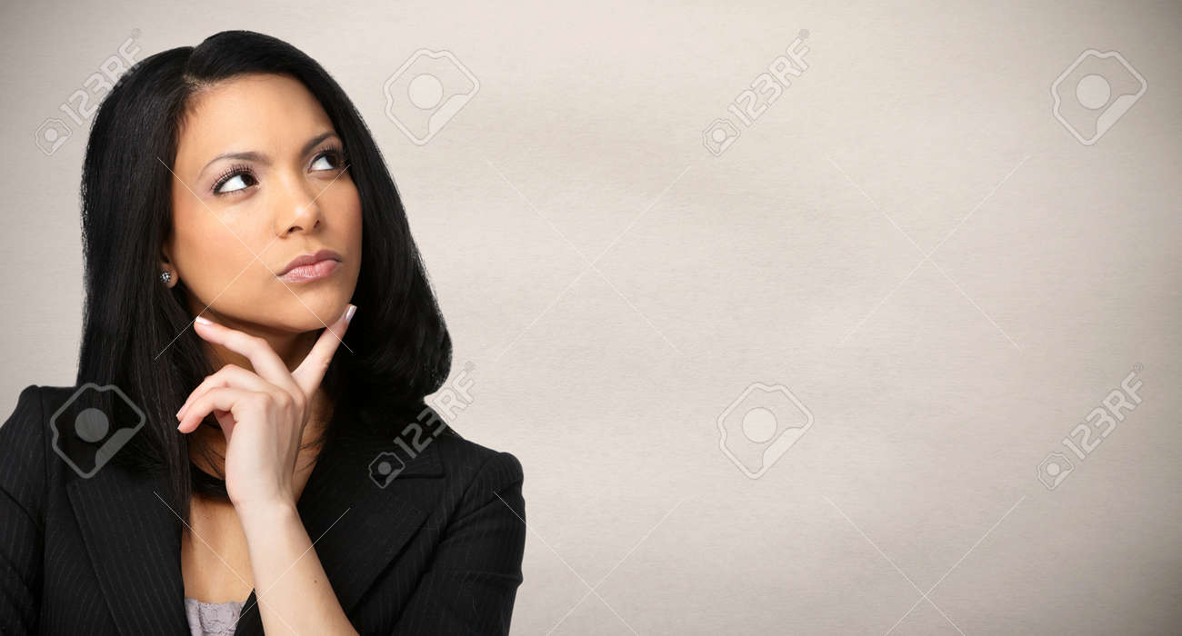 Beautiful Asian young business woman over gray wall background. Stock Photo - 52424217