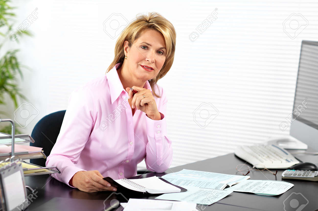mature business woman working with computer in the office. stock