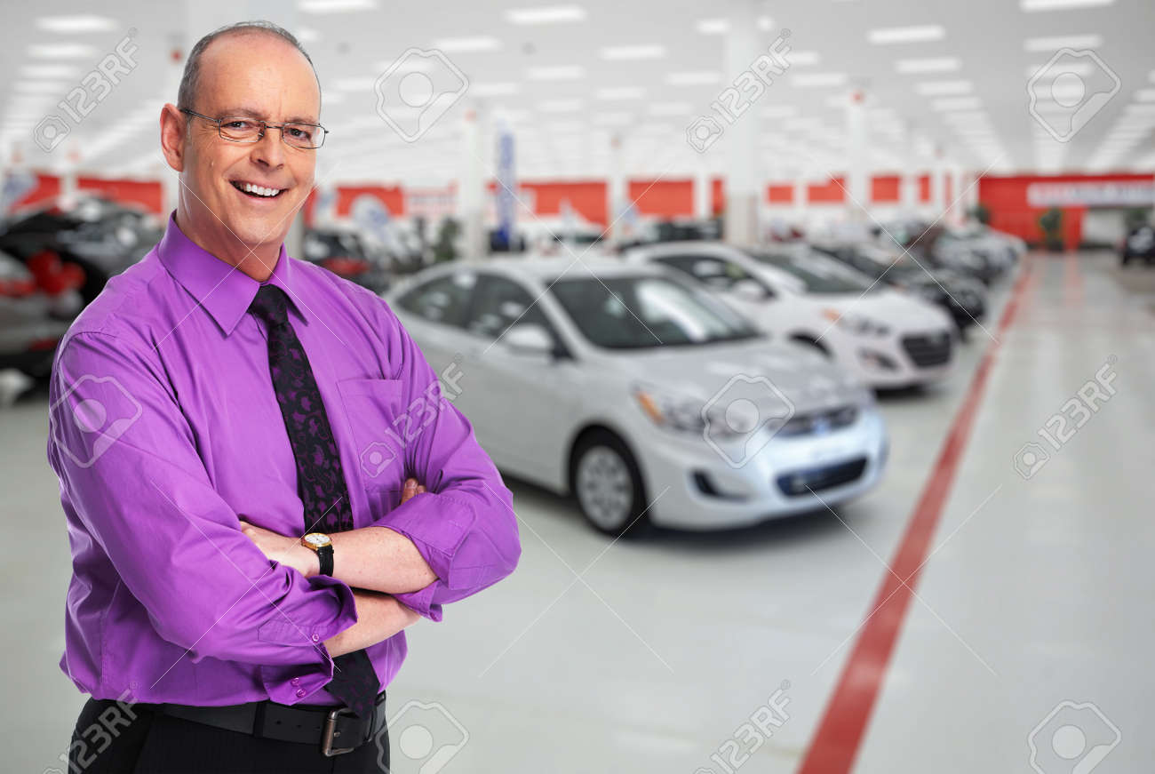 Car dealer man. Auto dealership and rental concept background. Standard-Bild - 53607621