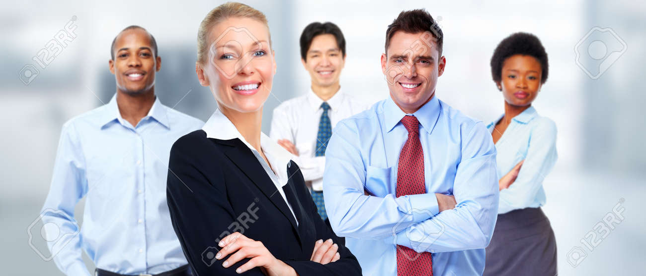 Beautiful young business woman over workers team background. Standard-Bild - 53983825