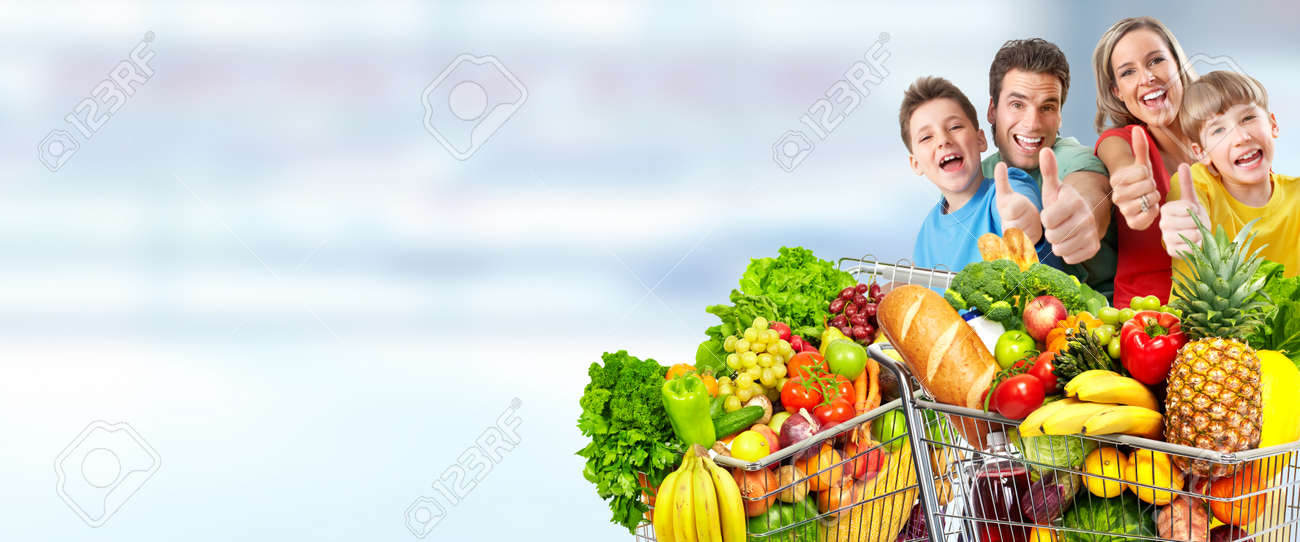 Happy family  with grocery shopping cart over blue abstract background. Stock Photo - 53983881