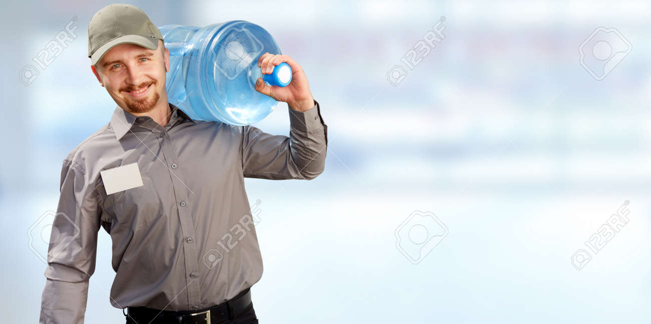 Water delivery service man with big bottle over blue background. - 54200198