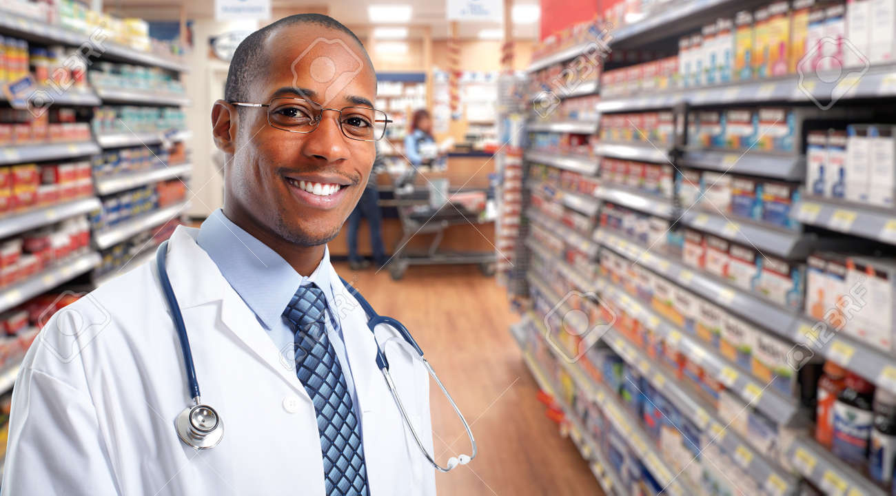 African-american pharmacist over pharmacy background. - 54900021