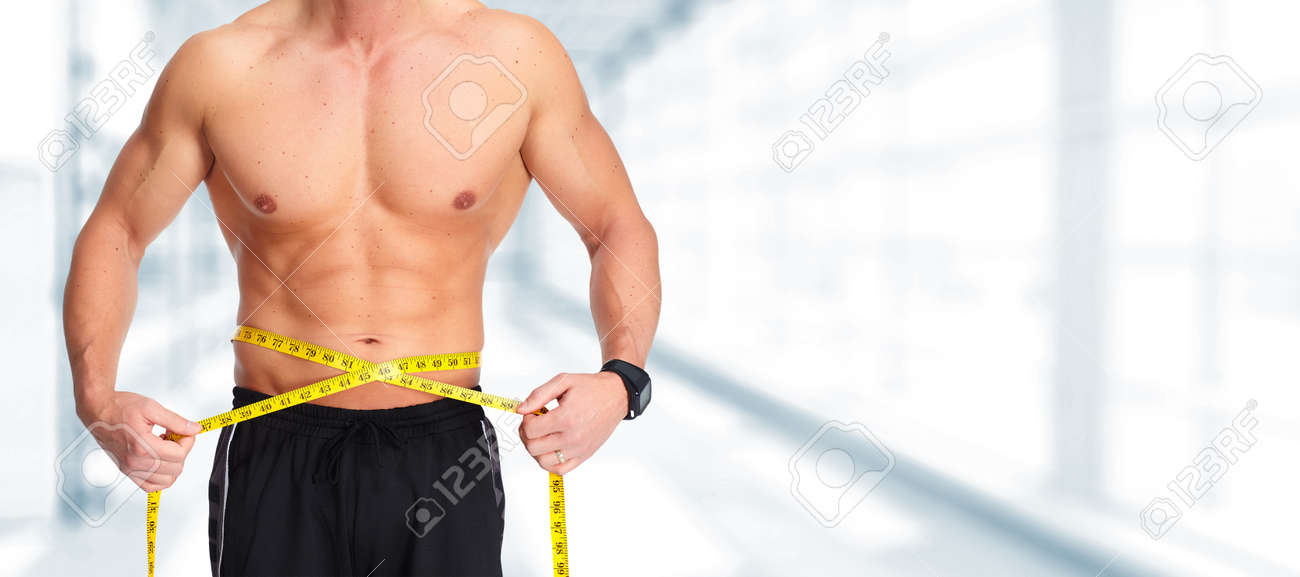 strong man abdomen with measuring tape weight loss stock photo