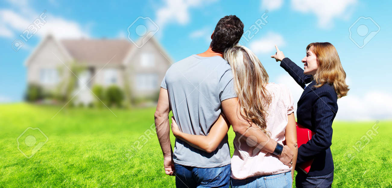 Real Estate agent woman near new house. Home for sale concept. Standard-Bild - 56592689