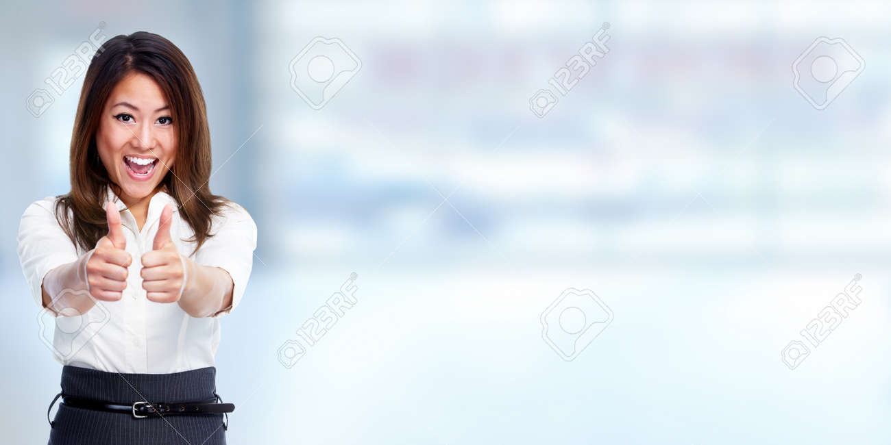 Happy chinese business woman over blue background. Standard-Bild - 57949306