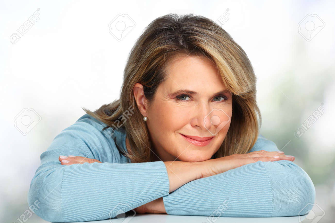 Beautiful senior woman portrait over blurred background. Standard-Bild - 58074351