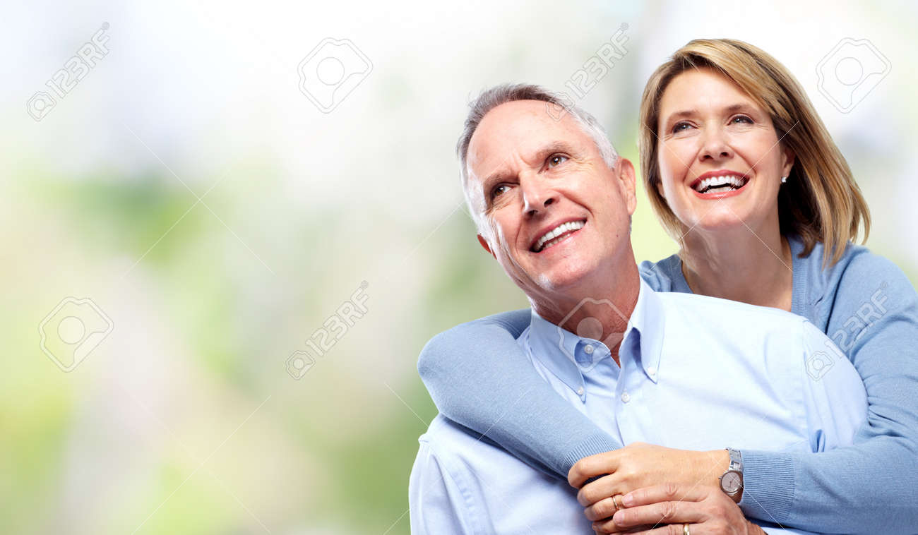 Elderly couple in love over green background. Stock Photo - 61494432