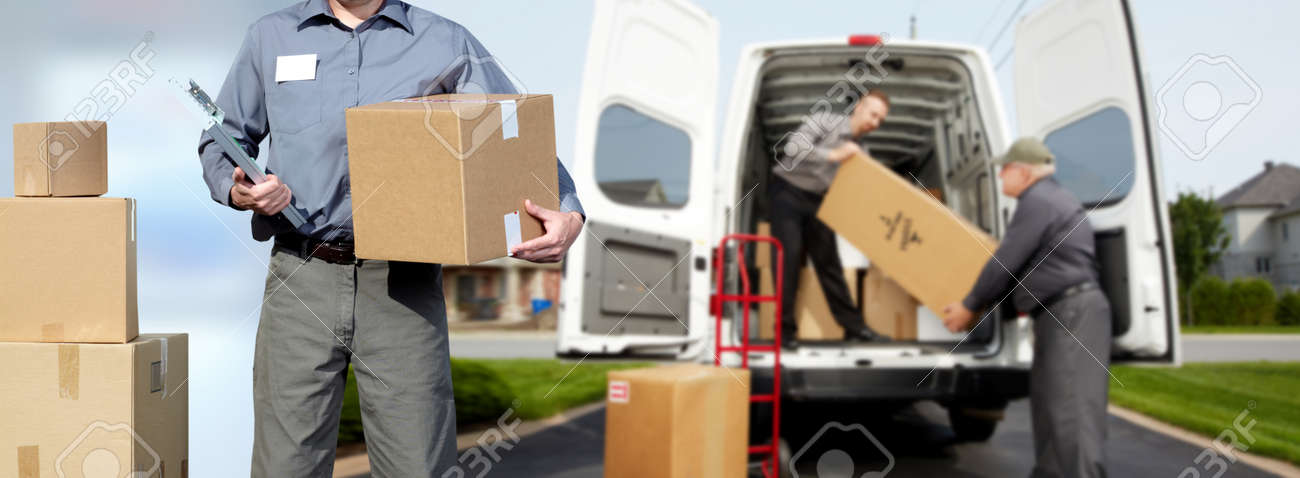 Smiling postman with a box near shipping truck. Stock Photo - 61494434
