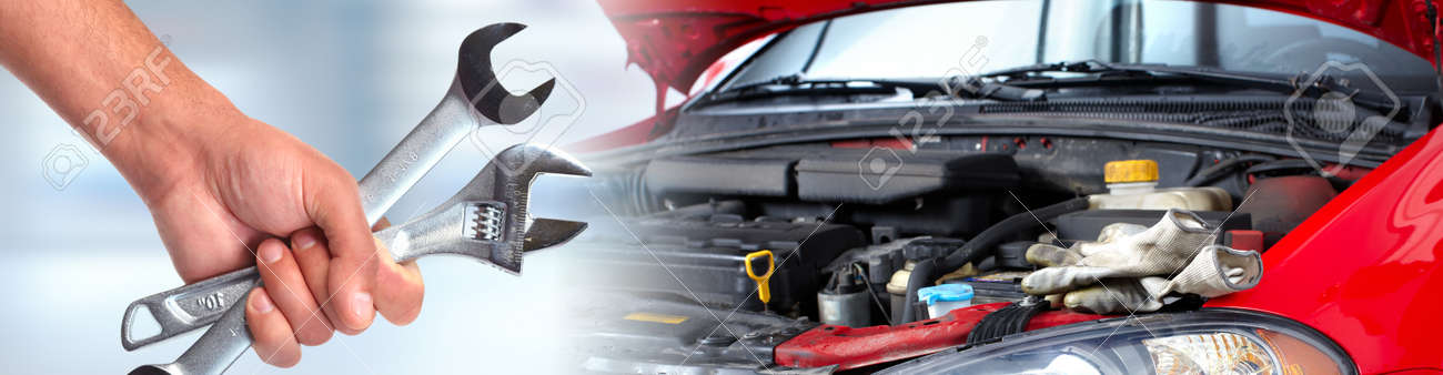 Hands of car mechanic with wrench in auto repair service. Standard-Bild - 62268864