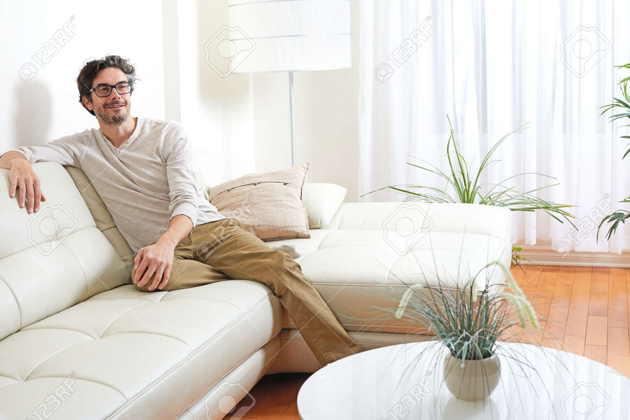 Handsome Man Relaxing At Cozy Modern Living Room Home. Stock Photo ...