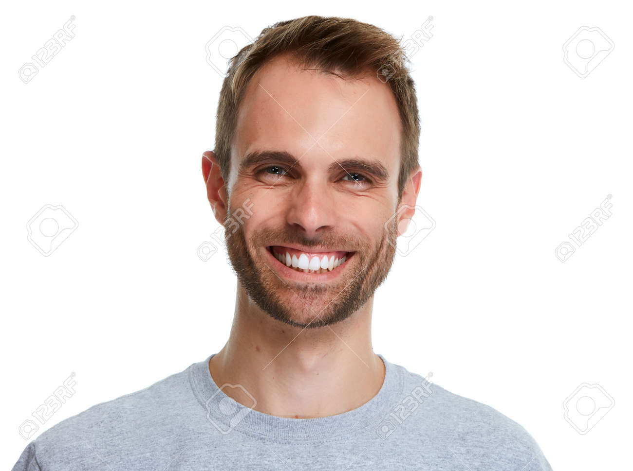 Smiling handsome man smile isolated over white background. - 66196689