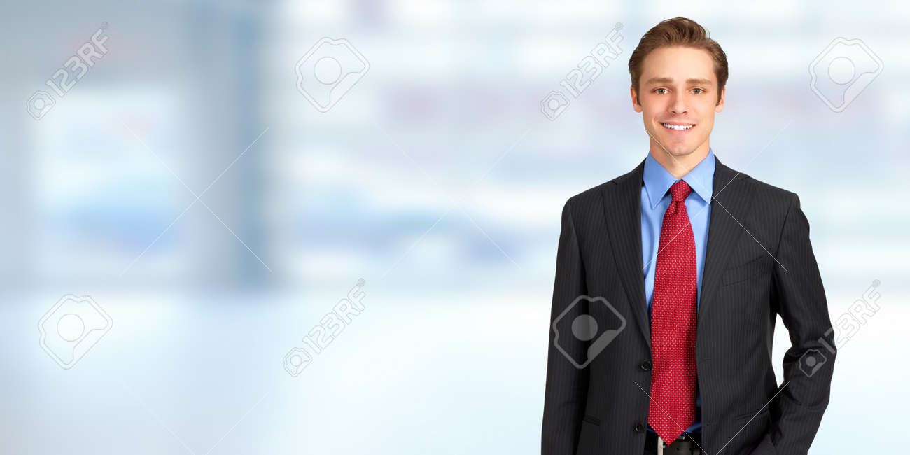 Young handsome caucasian business man over blue office, background Standard-Bild - 66303676