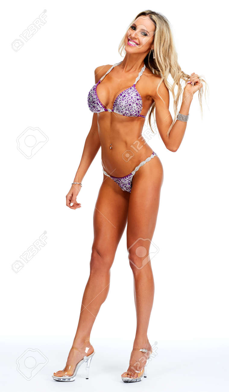 051381edf2 Stock Photo - Young beautiful athletic girl in sexy bikini. Sport and fitness  concept.