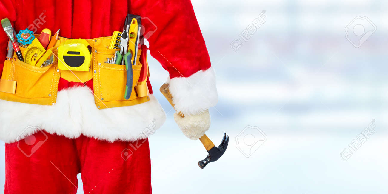 Santa construction worker with tool belt. Christmas renovation concept Standard-Bild - 66912418